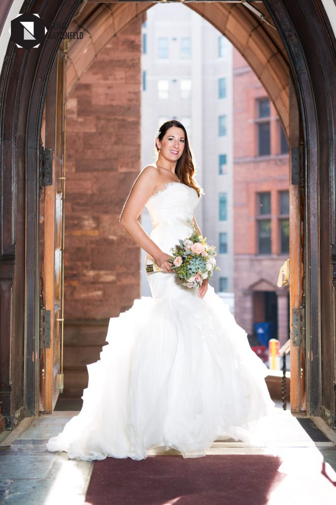 Bride in the doorway at St. Paul's Cathedral on Pearl St.