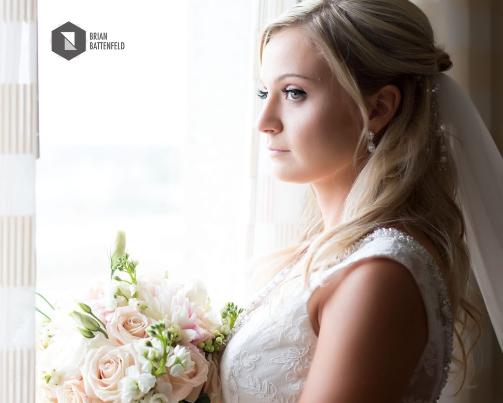 Bride looking through window