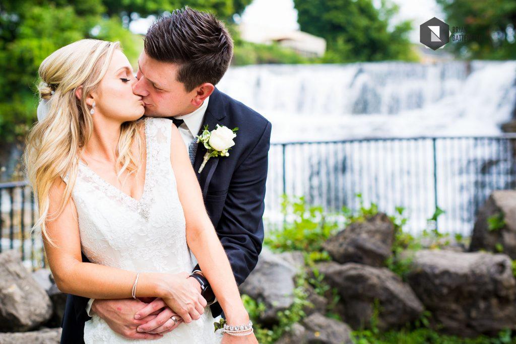 Bride and groom kissing at Glenn Falls