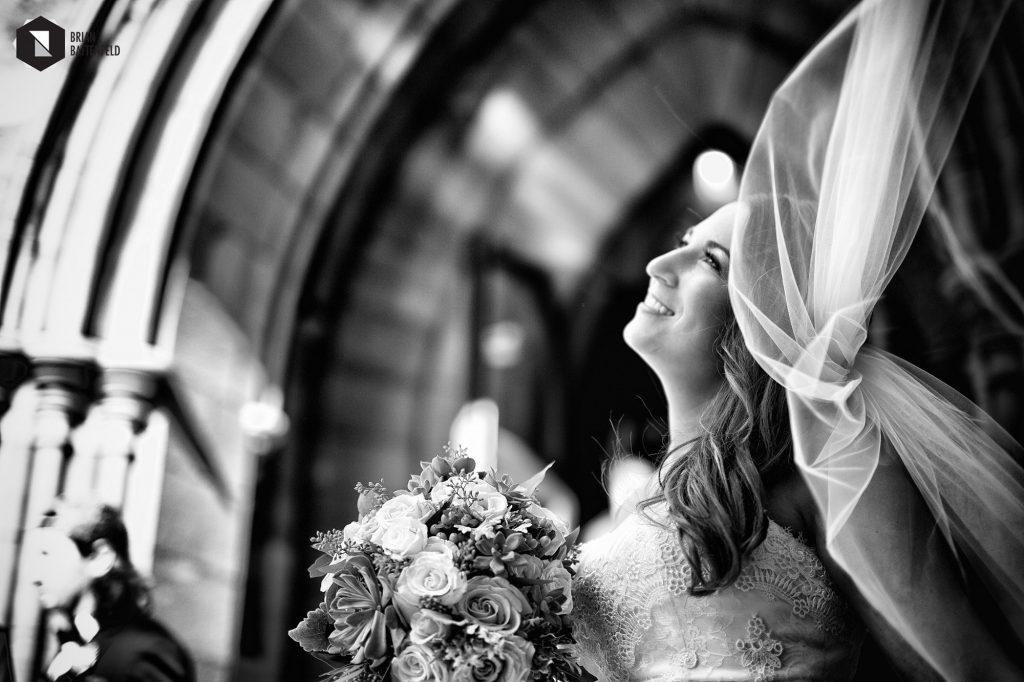 Bride's long veil blowing in wind
