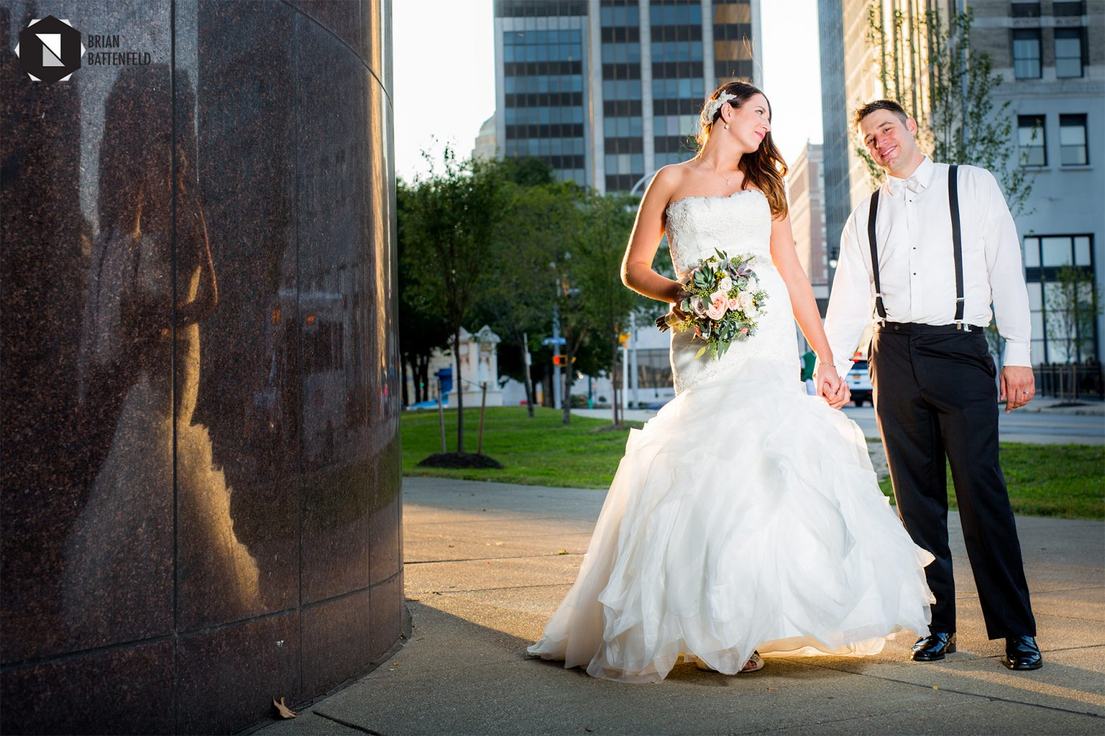 Bride and groom in sun outside Buffalo Public Library